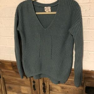 thick green knitted sweater